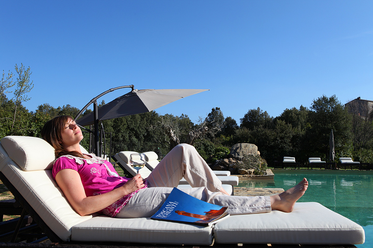 Relaxing poolside at Villa Collina by Inspirato, Tuscany, Italy